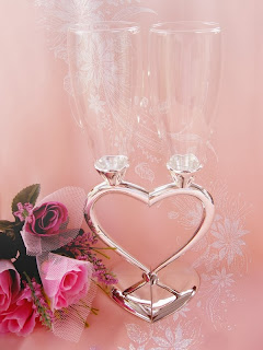 http://www.weddingforyou.co.nz/shop/wedding-toasting-flutes/1794-joined-heart-wedding-champagne-flutes.html