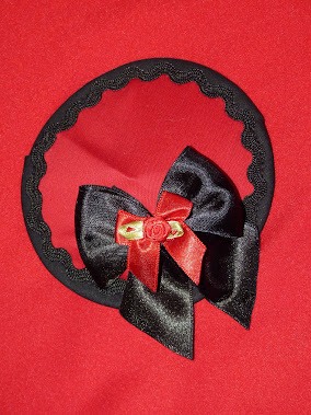 red and  black bow fascinator