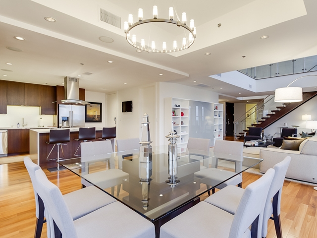 Photo of the penthouse showing modern kitchen and living room from the dinning room