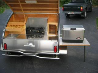 I Like A Couple Of Elements This Design The Center Storage Cooler Stove And Side Table That Is Pretty Neat