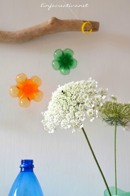 upcycle and home decor: garland made with the bases of plastic bottles