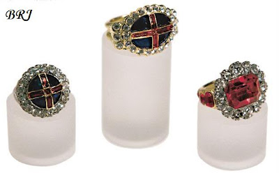 Queen Victoria's Coronation Ring (left), William IV's Coronation Ring (middle) and the Queen Consort's Coronation Ring (right)