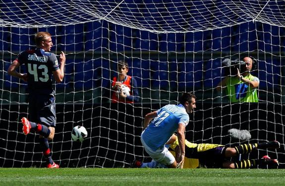 Lazio striker Miroslav Klose scores one of his five goals against Bologna