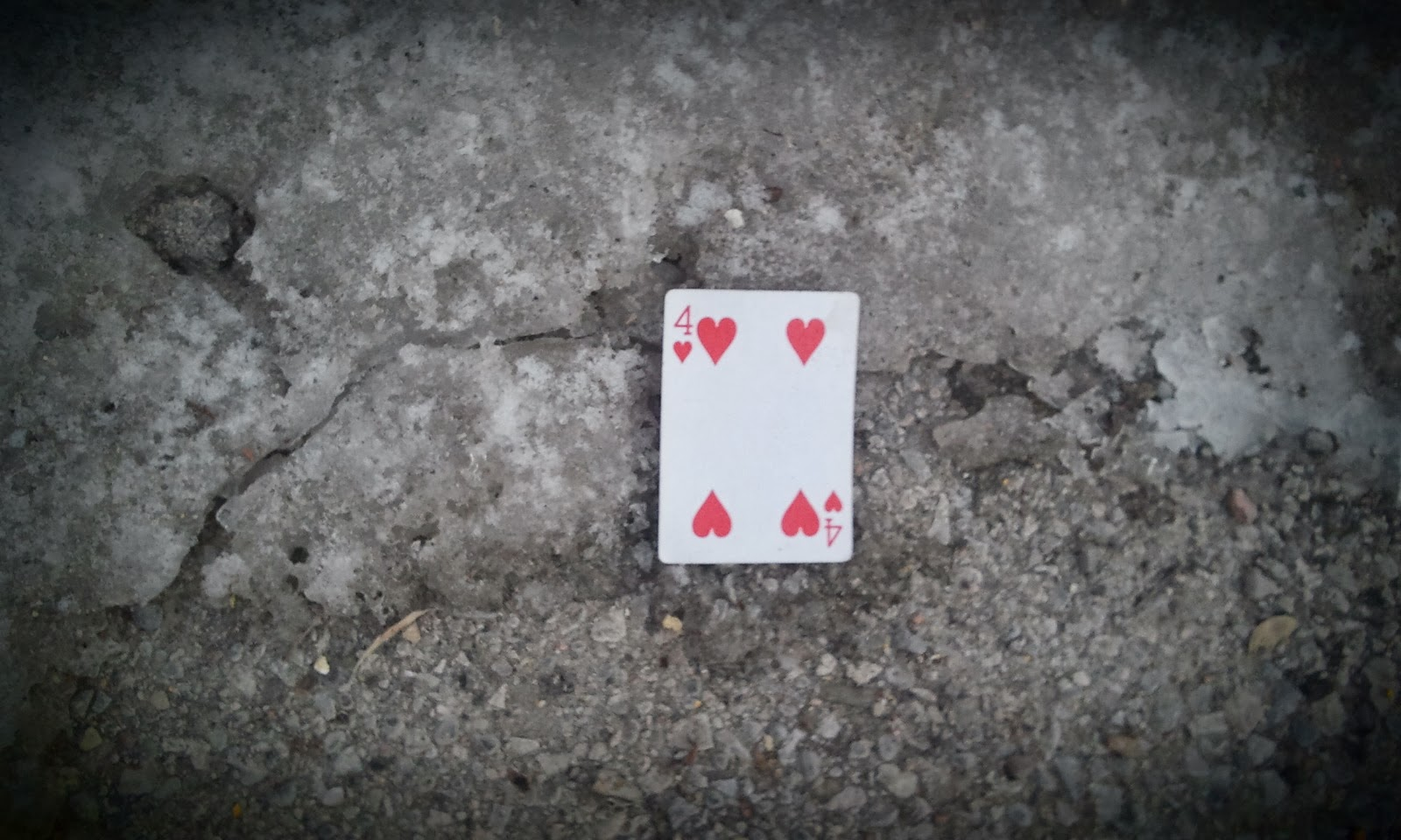 four of hearts card found on the ground