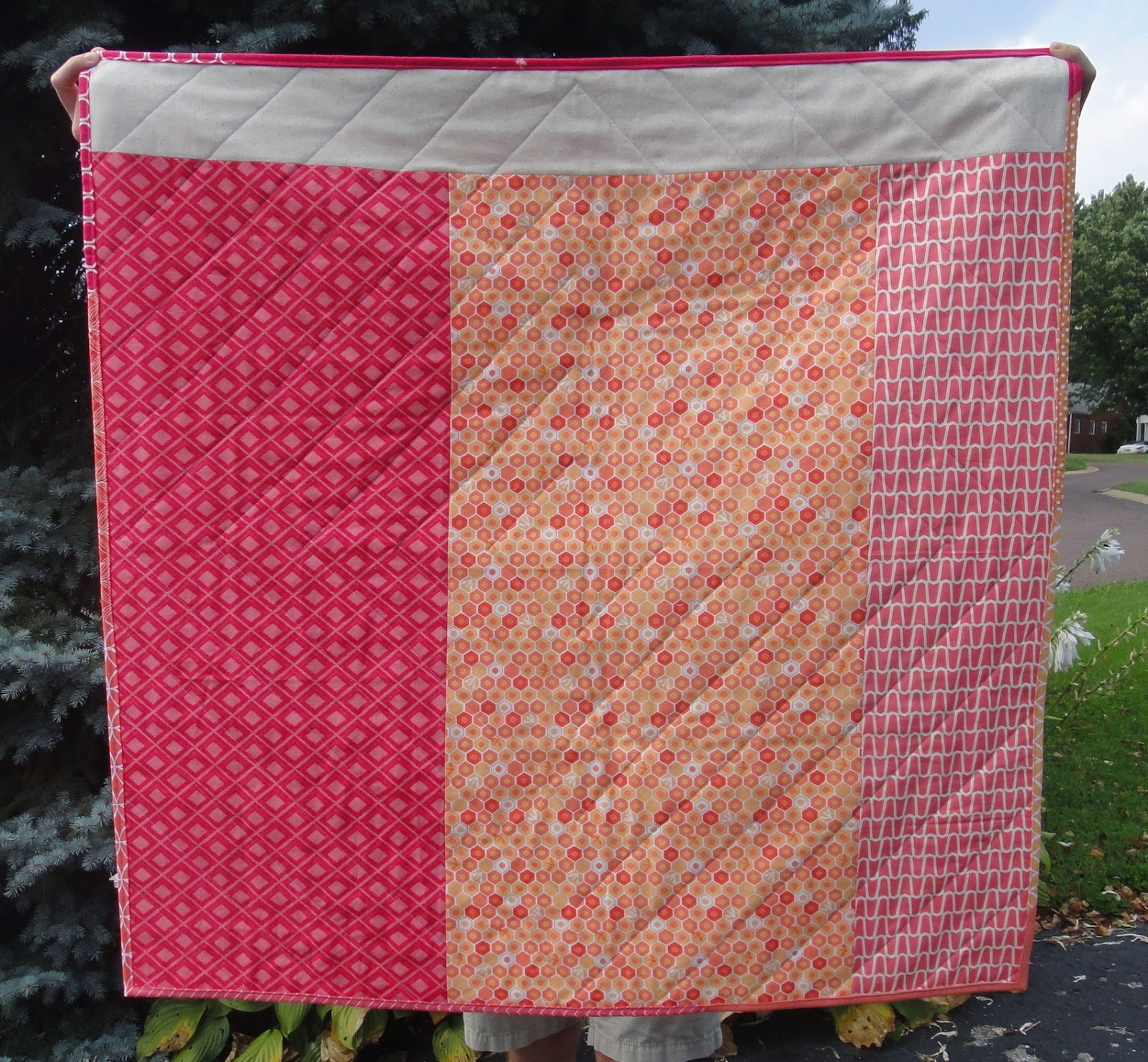 http://ablueskykindoflife.blogspot.com/2014/08/flippin-triangle-baby-quilt-finished.html