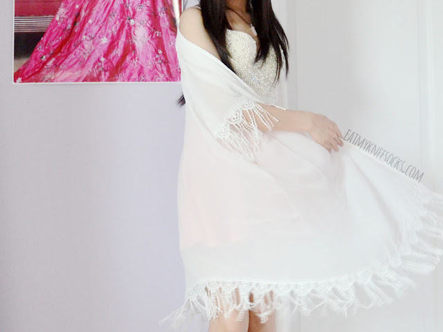 Kimonos are perfect for adding a boho-chic vibe to any summer outfit, like this white tassel-trim fringed longline kimono from SheIn.