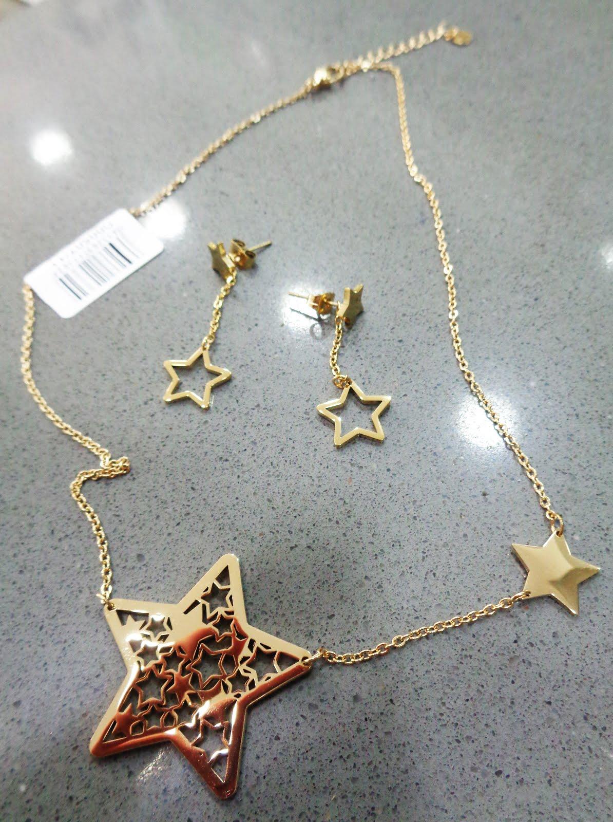 Gargantilla Marea, dorada, con estrellas y pendientes a juego