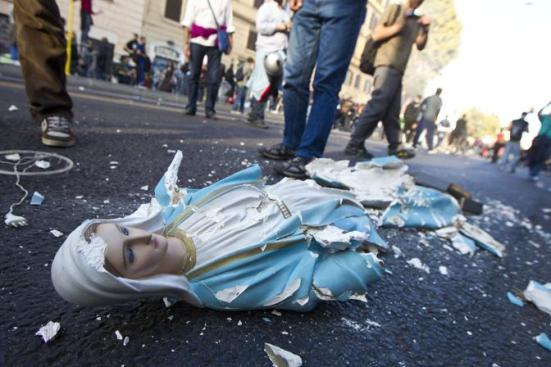 virgin mary statue destroyed and urinated