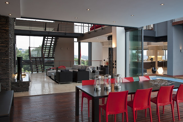 Picture of black table and red chairs on the covered terrace