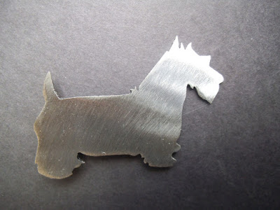 https://www.etsy.com/listing/152659224/miniature-schnauzer-magnet-holds-5lbs