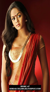 Karthika Nair in red low hip saree