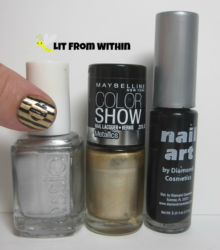 Bottle shot:  Essie No Place Like Chrome, Maybelline Bold Gold, black nail art striper