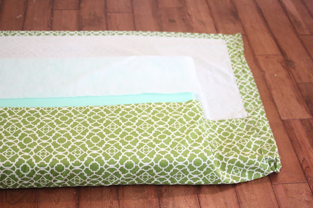 easy no sew cushion with foam and safety pins with a curtain panel as fabric via www.goldenboysandme.com