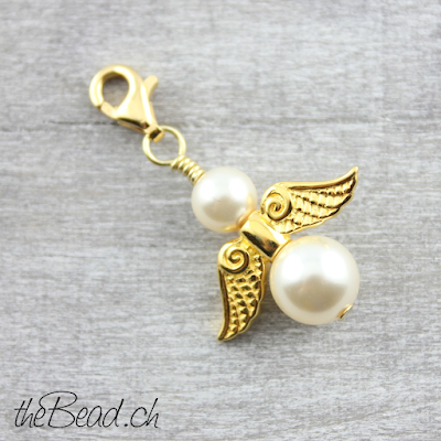 http://www.thebead.ch/product_info.php?info=p1326_charm-engel-925-silber-vergoldet---perlenfarbe-zur-wahl-.html