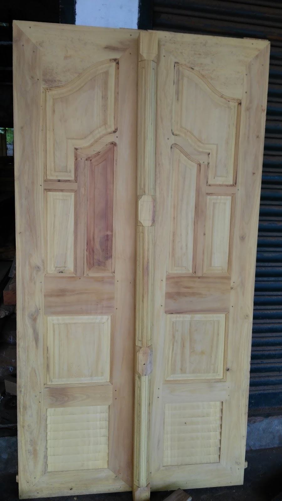 Kerala style carpenter works and designs november 2015 for Double door design