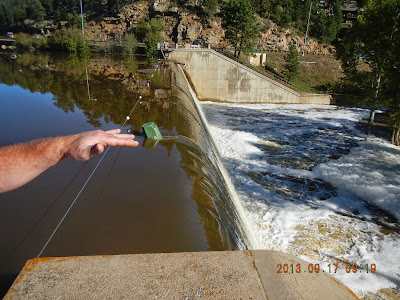 Photo: Normal safe operation of a dam with water flowing past the dam through the defined spillway structure.