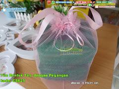 Tile Bentuk Tas Dengan Pegangan