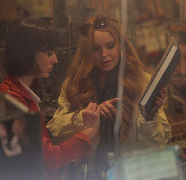 Lindsay Lohan checking out a book in a  Vintage Shop in Brooklyn
