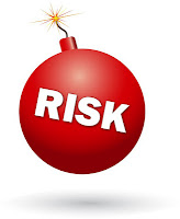 """cartoon image of a red blowing bomb, labeled """"RISK"""""""