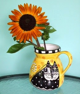 autumn beauty sunflower in a laurel burch cat vase