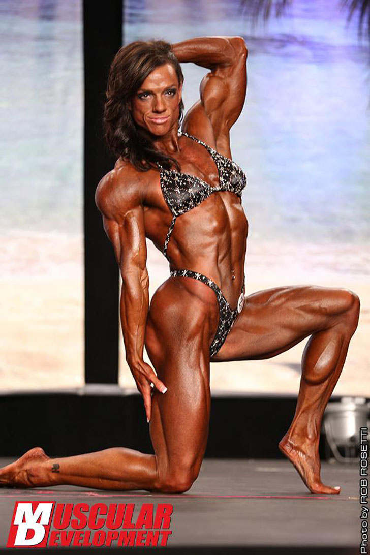 Sheila Bleck Flexing Her Muscles At The IFBB 2012 Tampa Bay Pro