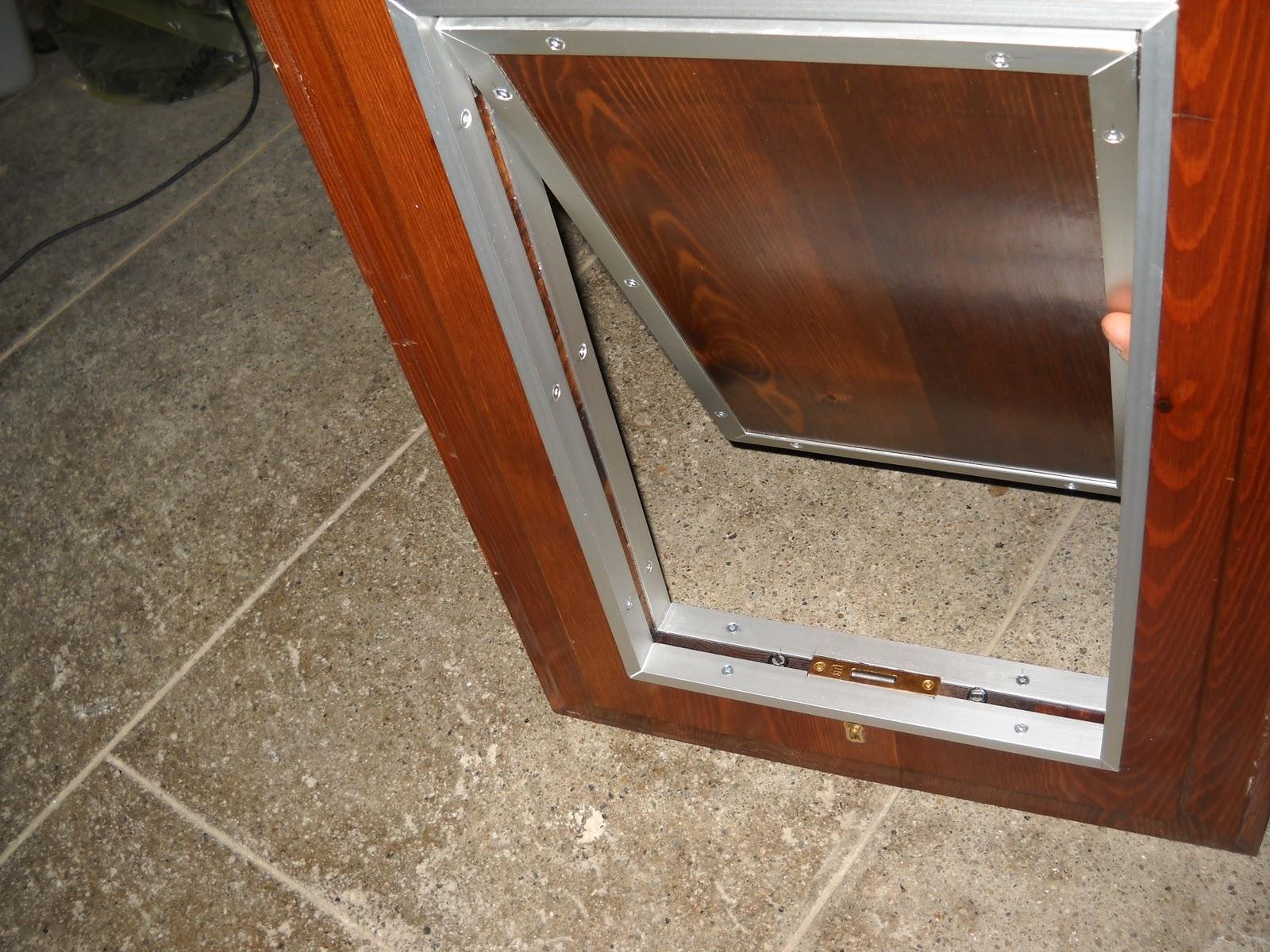Porte basculanti per cani for Finestra basculante