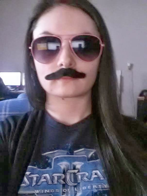 Jennifer Elizabeth Kendrick displaying her exquisite sense of humor and serious gamer cred via moustach + starcraft II tee shirt