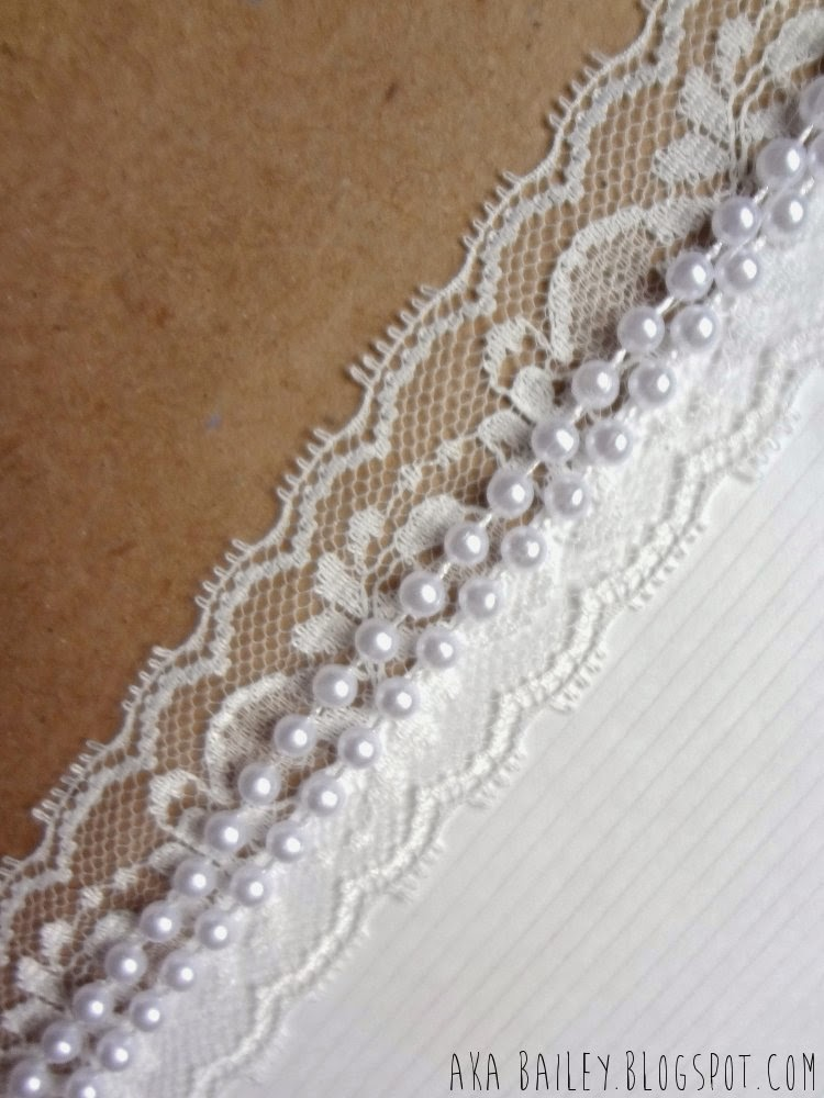 Brown and white gift wrap with lace and pearls