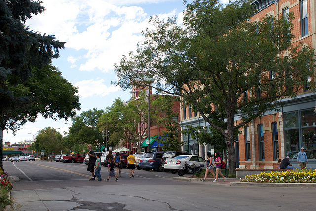 Pedestrians walking across the street in Old Town, Fort Collins