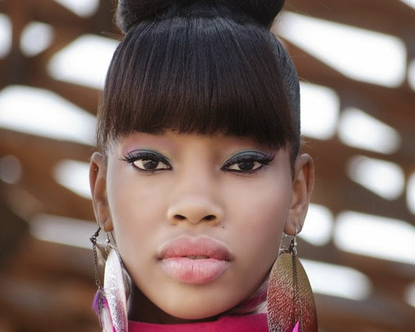 Black Women Buns Hairstyles with Bangs