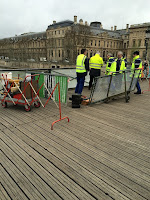 french workers repair lock damaged bridge 1