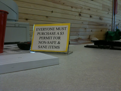 Desktop published sign reading Everyone must purchase a $3 permit for non-safe and sane items