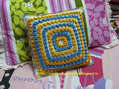 Crochet wiggles square cushion 1