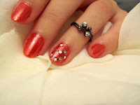 Simple nail art idea, with silver stars.
