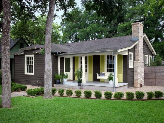 little brown house with lime green shutters
