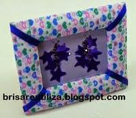 http://brisareutiliza.blogspot.com.es/2014/10/marco-de-fotos-conn-carton-y-tela.html