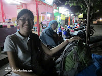 Sitting on a bamboo waiting area at Probolinggo