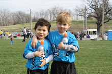 Mateo with his cousin Max at their first soccer game