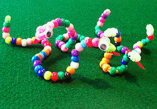 Tessa's pony bead snake family. Note her use of pattern on the mommy snake.
