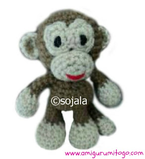 brown and beige crochet monkey