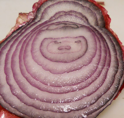 face in a red onion slice