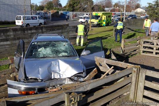 "A car driven by a male, with passengers, smashed through a 10 rail 6x1"" timber fence of the Stortford Lodge Saleyards in Southampton St West, Hastings, and crashed through another pen before coming to a halt. Police and St John Ambulance attended. photograph"