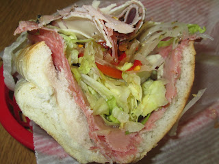 ... cheese, lettuce, tomatoes, onions, and pepper relish on a soft roll