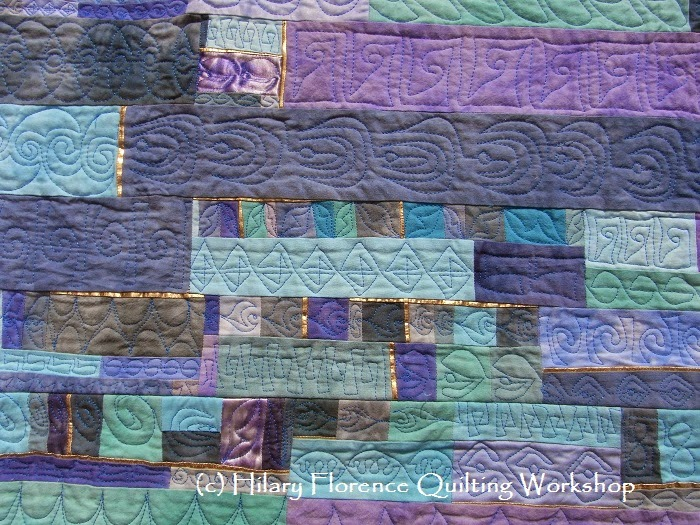 Art quilt, hand dyed with procion MX dyes, pieced, gold insets, free motion quilted, original design, Hilary Florence Quilting Workshop