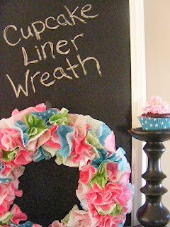 http://www.imperfecthomemaking.com/2012/02/cheerful-wreath-from-cupcake-liners.html