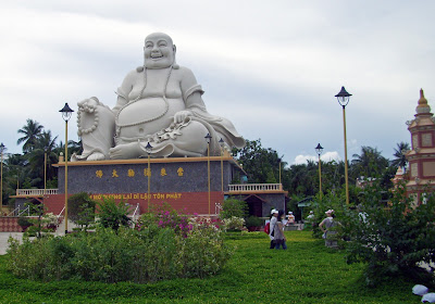 Buddha statue sitting in the Vinh Trang Pagoda