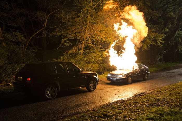 A car in a police convoy is set alight by a masked person in Line of Duty, BBC2