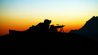 Soldiers siluets in mountain with sunset