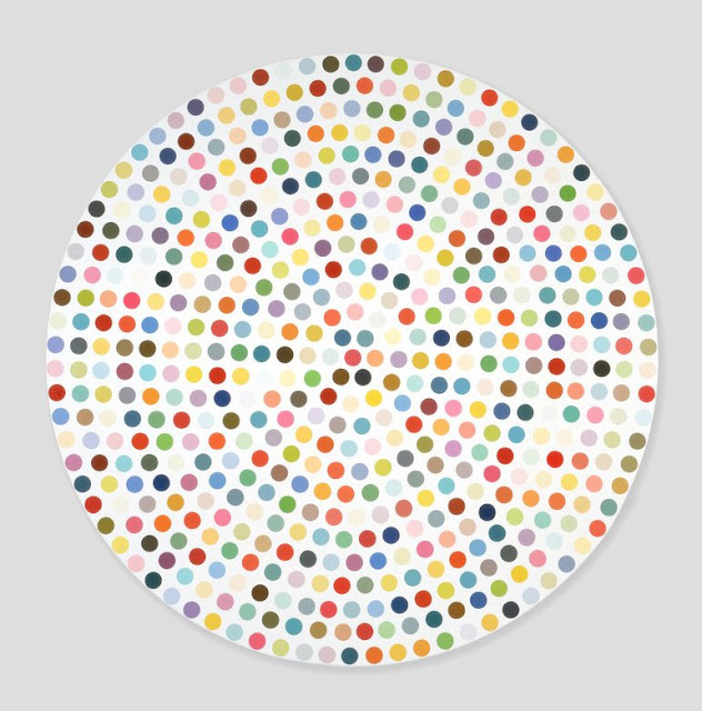 White circle with multicolored dots arranged in circles inside it