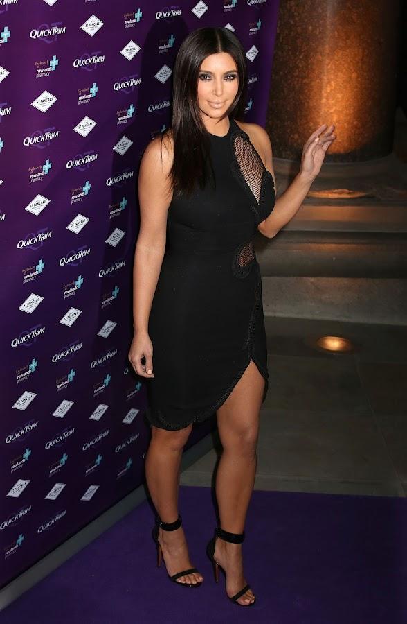 Kim Kardashian poses for photographers